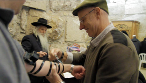 Sal Wraps Tefillin on guy