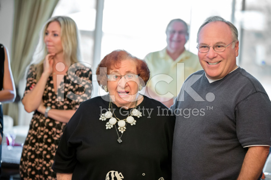 stock-photo-57699950-senior-adult-mother-and-senior-son-looking-at-camera