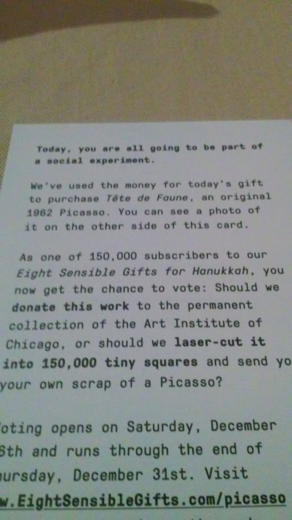 If you can't read this, it basically says that they used the money to buy an original Picasso, and you have to go to this website to vote whether to donate it to an art museum or cut it into 150,000 tiny squares.
