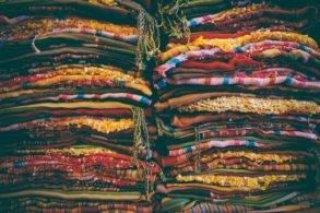 stacks of brightly colored fabric stacked high